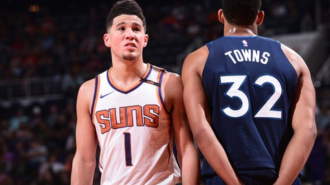 PHOENIX, AZ - NOVEMBER 11:  Devin Booker #1 of the Phoenix Suns and Karl-Anthony Towns #32 of the Minnesota Timberwolves during the game on November 11, 2017 at Talking Stick Resort Arena in Phoenix, Arizona. NOTE TO USER: User expressly acknowledges and agrees that, by downloading and or using this photograph, user is consenting to the terms and conditions of the Getty Images License Agreement. Mandatory Copyright Notice: Copyright 2017 NBAE (Photo by Michael Gonzales/NBAE via Getty Images)