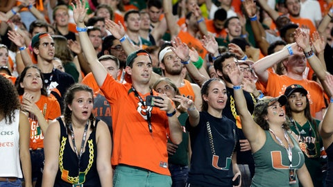 Miami fans cheer during the second half of an NCAA college football game against Notre Dame, Saturday, Nov. 11, 2017, in Miami Gardens, Fla. Miami won 41-8. (AP Photo/Lynne Sladky)