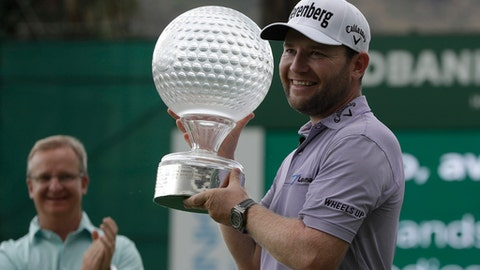 South Africa's Brandon Grace, holds the trophy after winning the Nedbank Golf Challenge at Sun City, South Africa, Sunday, Nov. 12, 2017. (AP Photo/Themba Hadebe)