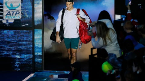 Roger Federer of Switzerland arrives to play his singles tennis match against Jack Sock of the United States at the ATP World Finals at the O2 Arena in London, Sunday, Nov. 12, 2017. (AP Photo/Kirsty Wigglesworth)