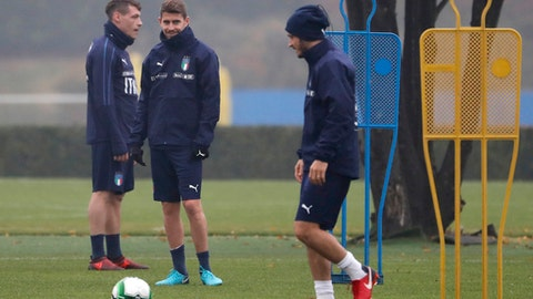 Italy's Jorginho, center, smiles with his teammates Alessandro Florenzi, right, and Andrea Belotti during a training session ahead of Monday's World Cup qualifying play-off return leg soccer match against Sweden, in Appiano Gentile, near Milan, Italy, Sunday, Nov. 12, 2017. (AP Photo/Antonio Calanni)