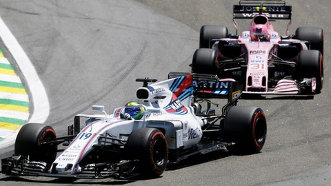 Williams driver Felipe Massa, of Brazil, steers his car ahead of Force India driver Esteban Ocon, of France, on the first lap of the Brazilian Formula One Grand Prix at the Interlagos race track in Sao Paulo, Brazil, Sunday, Nov. 12, 2017. (AP Photo/Nelson Antoine)