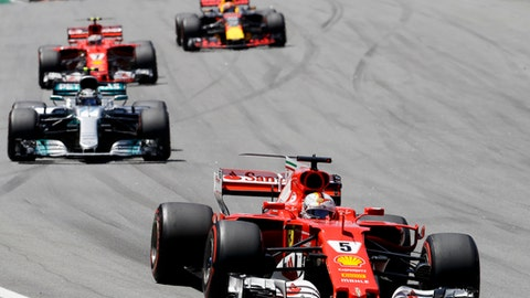 Ferrari driver Sebastian Vettel, of Germany, leads the race ahead of Mercedes Valtteri Bottas, of Finland, at the start of the Brazilian Formula One Grand Prix at the Interlagos race track in Sao Paulo, Brazil, Sunday, Nov. 12, 2017. (AP Photo/Andre Penner)