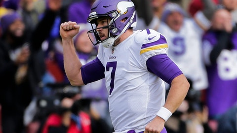 Minnesota Vikings quarterback Case Keenum (7) celebrates running back Latavius Murray's touchdown during the first half of an NFL football game against the Washington Redskins in Landover, Md., Sunday, Nov. 12, 2017. (AP Photo/Mark Tenally)