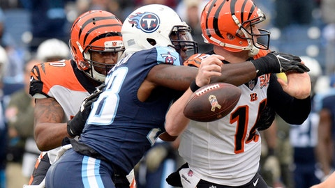 Tennessee Titans outside linebacker Brian Orakpo (98) sacks Cincinnati Bengals quarterback Andy Dalton (14) and forces a fumble in the first half of an NFL football game Sunday, Nov. 12, 2017, in Nashville, Tenn. The Titans recovered the ball on the play. (AP Photo/Mark Zaleski)