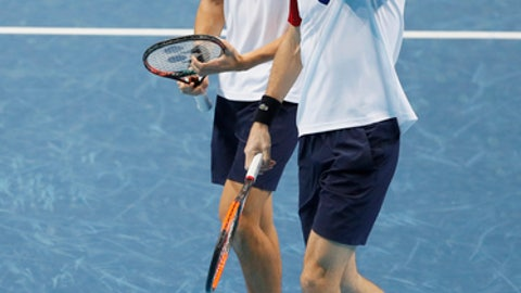 Pierre-Hugues Herbert of France, left, and Nicolas Mahut of France talk after they play a return Jean-Julien Rojer of the Netherlands and Horia Tecau of Romania during their doubles tennis match at the ATP World Finals at the O2 Arena in London, Sunday, Nov. 12, 2017. (AP Photo/Kirsty Wigglesworth)