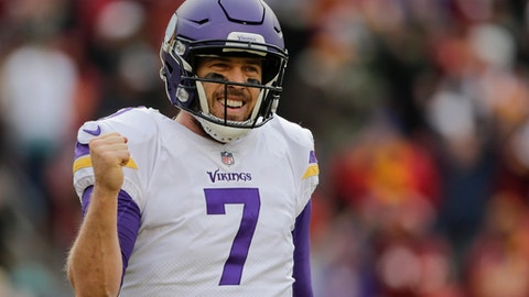 Minnesota Vikings quarterback Case Keenum (7) celebrates wide receiver Jarius Wright's touchdown during the second half of an NFL football game against the Washington Redskins in Landover, Md., Sunday, Nov. 12, 2017. (AP Photo/Mark Tenally)