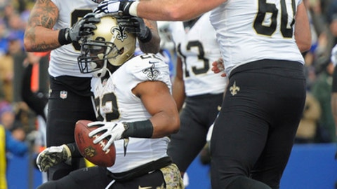New Orleans Saints running back Mark Ingram (22) celebrates with teammate Max Unger, right, and Michael Hoomanawanui after scoring his third touchdown of the game during the second half of an NFL football game against the Buffalo Bills, Sunday, Nov. 12, 2017, in Orchard Park, N.Y. (AP Photo/Adrian Kraus)