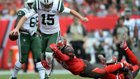 New York Jets quarterback Josh McCown (15) gets tripped up by Tampa Bay Buccaneers middle linebacker Kwon Alexander (58) during the first half of an NFL football game Sunday, Nov. 12, 2017, in Tampa, Fla. (AP Photo/Jason Behnken)