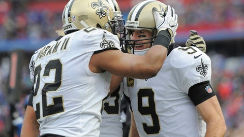 New Orleans Saints running back Mark Ingram (22) celebrates with quarterback Drew Brees (9) after Brees rushed for a touchdown during the second half of an NFL football game against thre Buffalo Bills, Sunday, Nov. 12, 2017, in Orchard Park, N.Y. (AP Photo/Adrian Kraus)