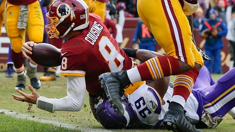 Washington Redskins quarterback Kirk Cousins (8) scores on a quarterback keeper during the second half of an NFL football game against the Minnesota Vikings in Landover, Md., Sunday, Nov. 12, 2017. (AP Photo/Alex Brandon)