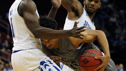 Monmouth's Micah Seaborn (10) is blocked by Seton Hall's Michael Nzei (1) and Myles Powell defend during the first half of an NCAA college basketball game in Newark, N.J., Sunday, Nov. 12, 2017. (AP Photo/Rich Schultz)