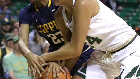 Coppin State center Chance Graham (23) and Baylor guard Natalie Chou (24) fight for the ball in the first half of an NCAA college basketball game Sunday, Nov. 12, 2017, in Waco, Texas. (AP Photo/Jerry Larson)