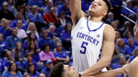 Vermont's Anthony Lamb, bottom, draws a charging foul on Kentucky's Kevin Knox (5) during the second half of an NCAA college basketball game, Sunday, Nov. 12, 2017, in Lexington, Ky. (AP Photo/James Crisp)