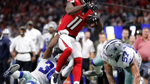 Dallas Cowboys cornerback Anthony Brown (30) and Dallas Cowboys outside linebacker Damien Wilson (57) stop Atlanta Falcons wide receiver Julio Jones (11) during the first half of an NFL football game, Sunday, Nov. 12, 2017, in Atlanta. (AP Photo/David Goldman)