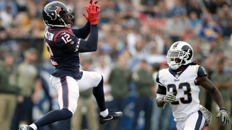 Houston Texans wide receiver Bruce Ellington, left, misses a pass under pressure from Los Angeles Rams cornerback Nickell Robey-Coleman during the first half of an NFL football game Sunday, Nov. 12, 2017, in Los Angeles. (AP Photo/Jae C. Hong)