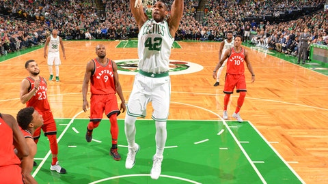 BOSTON, MA - NOVEMBER 12: Al Horford #42 of the Boston Celtics dunks the ball during the game against the Toronto Raptors on November 12, 2017 at the TD Garden in Boston, Massachusetts. NOTE TO USER: User expressly acknowledges and agrees that, by downloading and or using this photograph, User is consenting to the terms and conditions of the Getty Images License Agreement. Mandatory Copyright Notice: Copyright 2017 NBAE (Photo by Jesse D. Garrabrant/NBAE via Getty Images)