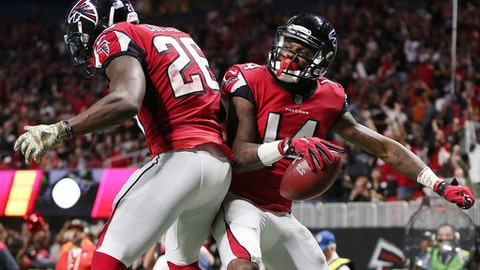 Atlanta Falcons wide receiver Justin Hardy (14) celebrates his touchdown with Atlanta Falcons running back Tevin Coleman (26) during the second half of an NFL football game against the Dallas Cowboys, Sunday, Nov. 12, 2017, in Atlanta. (AP Photo/John Bazemore)