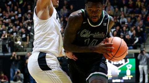 Chicago State guard Fred Sims Jr., right, tries to get past defending Purdue guard Carsen Edwards in the second half of an NCAA college basketball game, Sunday, Nov. 12, 2017, in West Lafayette, Ind. Purdue won 111-42. (AP Photo/R Brent Smith)