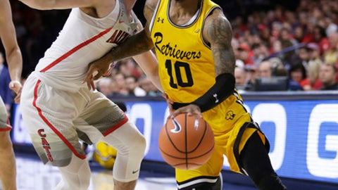 UMBC guard Jairus Lyles (10) drives on Arizona guard Alex Barcello in the first half during an NCAA college basketball game, Sunday, Nov. 12, 2017, in Tucson, Ariz. (AP Photo/Rick Scuteri)