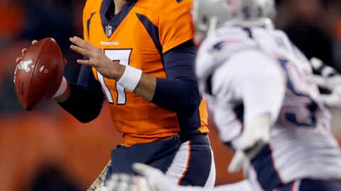 Denver Broncos quarterback Brock Osweiler (17) looks to throw as New England Patriots outside linebacker Elandon Roberts (52) pursues during the second half of an NFL football game against the New England Patriots Sunday, Nov. 12, 2017, in Denver. (AP Photo/David Zalubowski)