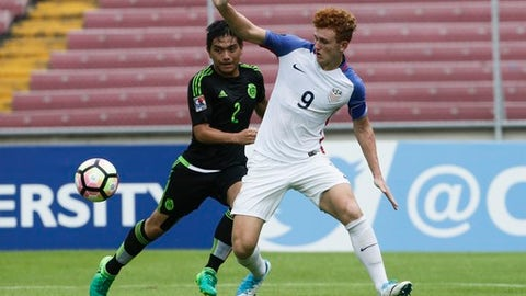 "FILE - In this May 7, 2017, file photo, United States' Josh Sargent, right, and Mexico's Adrian Vazquez fight for the ball during the CONCACAF under-17 soccer championship final in Panama City, Panama. Josh Sargent remembered when coach John Hackworth greeted the U.S. Under-17 team at breakfast in India last month and told players the American senior team had failed to qualify for next year's World Cup. ""Everybody thought he was joking,"" Sargent said. In the wake of the failure, Sargent has been promoted to the national team along with Weston McKennie and Tyler Adams for Tuesday's exhibition at Portugal. (AP Photo/Arnulfo Franco, File)"