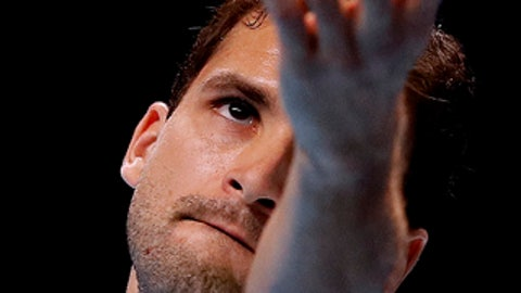 Grigor Dimitrov of Bulgaria serves to Dominic Thiem of Austria during their singles tennis match at the ATP World Finals at the O2 Arena in London, Monday, Nov. 13, 2017. (AP Photo/Kirsty Wigglesworth)