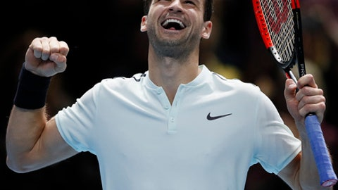 Grigor Dimitrov of Bulgaria celebrates after winning his singles tennis match against Dominic Thiem of Austria at the ATP World Finals at the O2 Arena in London, Monday, Nov. 13, 2017. (AP Photo/Kirsty Wigglesworth)