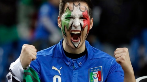 A Italy fan, his face painted in the colors of the national flag, cheers prior to the World Cup qualifying play-off second leg soccer match between Italy and Sweden, at the Milan San Siro stadium, Italy, Monday, Nov. 13, 2017. (AP Photo/Antonio Calanni)