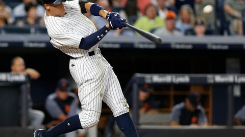 FILE - In this July 31, 2017, file photo, New York Yankees' Aaron Judge hits a solo home run during the fifth inning of a baseball game against the Detroit Tigers at Yankee Stadium in New York. Aaron Judge of the Yankees and Cody Bellinger of the Dodgers are favored to win Rookie of the Year honors when the votes are announced Monday night, Nov. 13, 2017. (AP Photo/Kathy Willens, File)