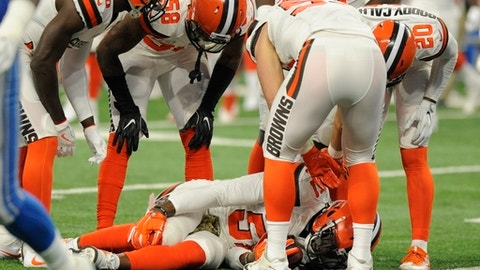 FILE - In this Nov. 12, 2017, file photo, Cleveland Browns outside linebacker Jamie Collins stays on the ground after a tackle by Detroit Lions offensive guard Graham Glasgow during the first half of an NFL football game, in Detroit. Browns starting linebacker Jamie Collins is done for the season with a sprained right knee ligament. (AP Photo/Jose Juarez, File)