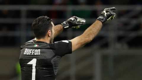 Italy goalkeeper Gianluigi Buffon gives directions to his teammates during the World Cup qualifying play-off second leg soccer match between Italy and Sweden, at the Milan San Siro stadium, Italy, Monday, Nov. 13, 2017. (AP Photo/Luca Bruno)