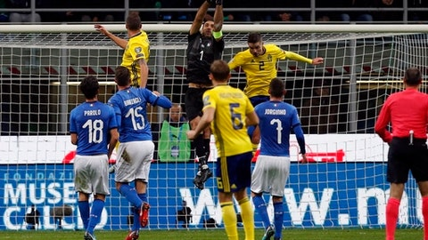 Italy goalkeeper Gianluigi Buffon reaches for the ball during the World Cup qualifying play-off second leg soccer match between Italy and Sweden, at the Milan San Siro stadium, Italy, Monday, Nov. 13, 2017. (AP Photo/Antonio Calanni)