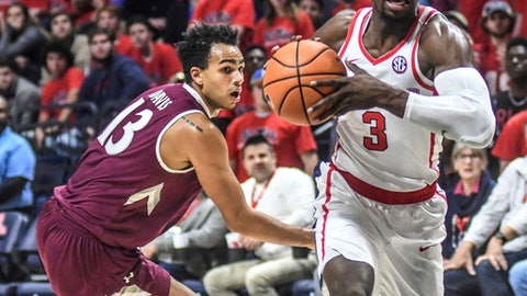 Mississippi's Terence Davis (3) gets past Eastern Kentucky forward Jackson Davis (13) during an NCAA college basketball game in Oxford, Miss., Monday, Nov. 13, 2017. (Bruce Newman/The Oxford Eagle via AP)