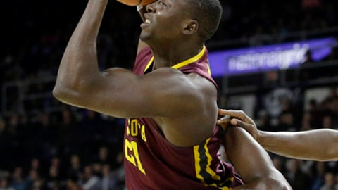 Minnesota's Bakary Konate, top, tries to control the ball as he tumbles over Providence's Isaiah Jackson, bottom, in the first half of an NCAA college basketball game Monday, Nov. 13, 2017, in Providence, R.I. (AP Photo/Steven Senne)