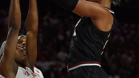 South Carolina's A'ja Wilson, right, shoots as Maryland's Kaila Charles defends in the first half of an NCAA basketball game, Monday, Nov. 13, 2017, in College Park, Md. (AP Photo/Gail Burton)