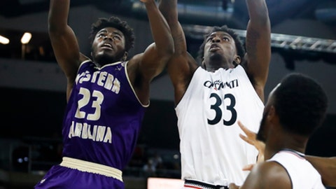 Cincinnati center Nysier Brooks (33) rebounds against Western Carolina forward Mike Amius (23) in the first half of an NCAA college basketball game, Monday, Nov. 13, 2017, at BB&T Arena in Newport, Ky. (AP Photo/John Minchillo)