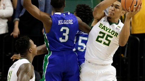 Baylor's Mark Vital (11) watches as forward Tristan Clark (25) comes down with an offensive rebound in front of Texas A M Corpus Christi's Joseph Kilgore (3) and Sean Rhea (15) in the first half of an NCAA college basketball game, Monday, Nov. 13, 2017, in Waco, Texas. (AP Photo/Tony Gutierrez)