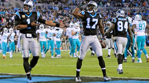 Carolina Panthers' Devin Funchess (17) and Cam Newton (1) celebrate their touchdown against the Miami Dolphins in the second half of an NFL football game in Charlotte, N.C., Monday, Nov. 13, 2017. (AP Photo/Mike McCarn)