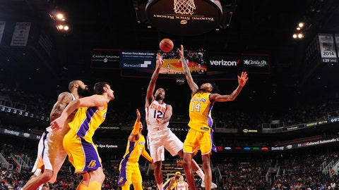 PHOENIX, AZ - NOVEMBER 13:  TJ Warren #12 of the Phoenix Suns goes to the basket against the Los Angeles Lakers on November 13, 2017 at Talking Stick Resort Arena in Phoenix, Arizona. NOTE TO USER: User expressly acknowledges and agrees that, by downloading and or using this photograph, user is consenting to the terms and conditions of the Getty Images License Agreement. Mandatory Copyright Notice: Copyright 2017 NBAE (Photo by Barry Gossage/NBAE via Getty Images)