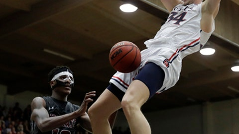 Saint Mary's center Jock Landale, right, dunks past New Mexico State forward Jemerrio Jones (10) during the second half of an NCAA college basketball game Monday, Nov. 13, 2017, in Moraga, Calif. (AP Photo/Marcio Jose Sanchez)