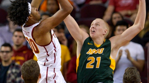 Southern California guard Elijah Stewart (30) drives on North Dakota State guard A.J. Jacobson (21) for a basket during the first half of an NCAA college basketball game, Monday, Nov. 13, 2017, in Los Angeles. (AP Photo/Gus Ruelas)