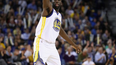 OAKLAND, CA - NOVEMBER 13:  Draymond Green #23 of the Golden State Warriors reacts after making a basket against the Orlando Magic at ORACLE Arena on November 13, 2017 in Oakland, California. NOTE TO USER: User expressly acknowledges and agrees that, by downloading and or using this photograph, User is consenting to the terms and conditions of the Getty Images License Agreement.  (Photo by Ezra Shaw/Getty Images)