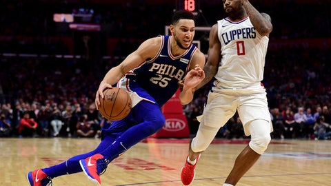 LOS ANGELES, CA - NOVEMBER 13:  Ben Simmons #25 of the Philadelphia 76ers drives on Sindarius Thornwell #0 of the LA Clippers the LA Clippers during a 109-105 win over the Clippers at Staples Center on November 13, 2017 in Los Angeles, California.  (Photo by Harry How/Getty Images)