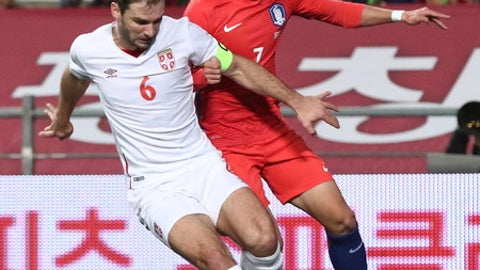 South Korea's Son Heung-min, right, fights for the ball against Serbia's Branislav Ivanovic during their friendly soccer match in Ulsan, South Korea, Tuesday, Nov. 14, 2017. (Kim In-chul/Yonhap via AP)