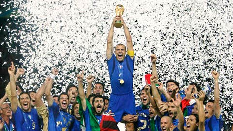 FILE - In this Sunday, July 9, 2006 file photo Fabio Cannavaro lifts the soccer World Cup trophy after Italy defeated France in the final in the Olympic Stadium in Berlin, Germany. On Nov. 13, 2017 after a scoreless draw with Sweden four-time champion Italy lost its World Cup qualifying playoff on 1-0 aggregate. Paradoxically, the start of Italy's decline can be traced back to 2006 — the year Italy won its fourth World Cup.  (AP Photo/Luca Bruno, Files)