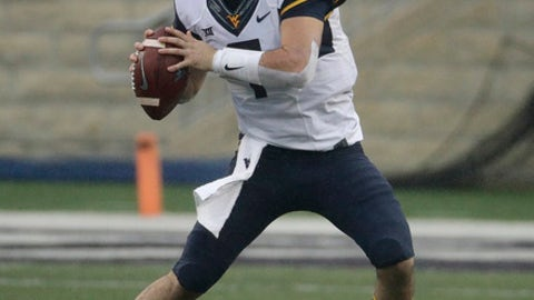 FILE - In this Nov. 11, 2017, file photo, West Virginia quarterback Will Grier (7) looks for a receiver during the first half of an NCAA college football game against Kansas State,in Manhattan, Kan. Much like the Heisman Trophy race, Baker Mayfield of Oklahoma is going to be tough to beat for the first-team quarterback spot when the AP All-America team comes out in December. But there is a second- and third-team and the shaggy, swashbuckling Grier should be in the mix for some recognition.  (AP Photo/Charlie Riedel, File)
