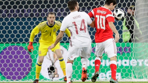 Spain's Nacho, left, struggles for the ball with Russia's Alan Dzagoev during the international friendly soccer match between Russia and Spain in St.Petersburg, Russia, Tuesday, Nov. 14, 2017. (AP Photo/Dmitri Lovetsky)