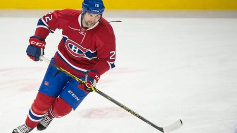 FILE - In this April 5, 2016, file photo, Montreal Canadiens' John Scott skates before an NHL hockey game against the Florida Panthers in Montreal. Enforcer turned NHL All-Star, Scott tried out acting, and it made him more nervous than fighting 250-pound rivals and playing in front of 20,000 fans. Maybe that's not his next career, but with a movie coming out, Scott is considering his next move. (Graham Hughes/The Canadian Press via AP, File)