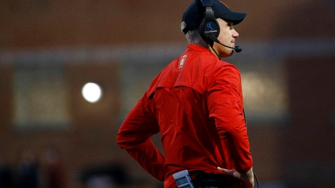 FILE - In this Saturday, Nov. 11, 2017, file photo, Maryland head coach DJ Durkin stands on the field during the first half of an NCAA college football game against Michigan in College Park, Md. Maryland needs two more wins to become bowl eligible, which means it's going to take an improbable sweep of No. 22 Michigan State and Penn State to get it done.  (AP Photo/Patrick Semansky, File)